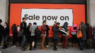 Shoppers queue to enter Selfridges in London
