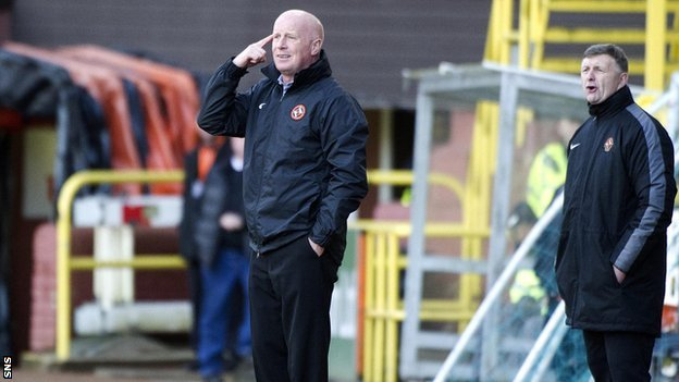 Dundee United manager Peter Houston and assistant Paul Hegarty