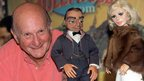 Gerry Anderson with two of his most famous puppets, Lady Penelope and Parker.