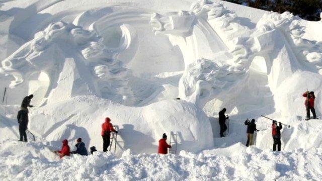 Snow sculpture of horses