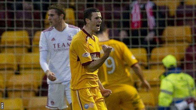 Jamie Murphy celebrates one of his two goals in Motherwell's win over Aberdeen