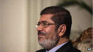 Mohammed Morsi poses during a photo opportunity at the presidential palace in Cairo, Egypt, Saturday, Dec. 8