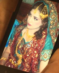 Mobile phone image of Asian bride
