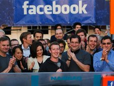 In this May 18, 2012 file photo provided by Facebook, Facebook founder, Chairman and CEO Mark Zuckerberg, center, rings the Nasdaq opening bell