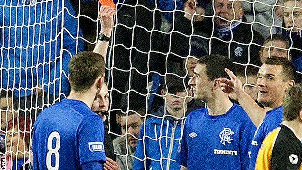 Lee Wallace (centre) is shown the red card against Annan