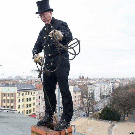 Master chimneysweep Norbert Skrobek on a rooftop in Berlin's Kreuzberg district - 27 December 2012