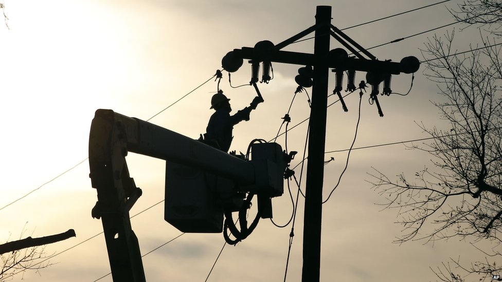 A Coast Electric Power Association lineman grounds a line on a replacement pole in McNeill, Mississippi  - Wednesday 26 December 2012