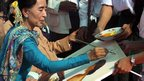 Burmese opposition leader Aung San Suu Kyi signing a painting by a party supporter in Peoples Square, Rangoon - 27 December 2012