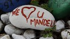A pebble pictured outside Nelson Mandela&#039;s Johannesburg home in Houghton - 27 December 2012
