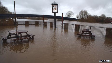 Floodwater in front of the new defences in Upton-upon-Severn