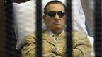 Egypt's ex-President Hosni Mubarak inside a barred cage in the police academy courthouse in Cairo, Egypt.