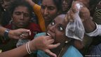 A woman prepares to swallow a live fish that has been dipped in homemade medicine  in the southern Indian city of Hyderabad