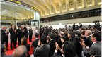 Executives of the Tokyo Stock Exchange and guests applaud during a ceremony to celebrate the last trading day of 2012