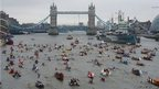 The flotilla of 1000 boats sails towards Tower Bridge during the Diamond Jubilee Thames River Pageant