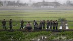 A group of North Korean musicians performed amid fields to greet farmers at Hwanggumpyong Island, near the town of Sinuiju and the Chinese border city of Dandong
