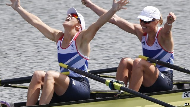 Katherine Grainger and Anna Watkins celebrate winning gold in the Women's Double Sculls at the London 2012 Olympic Games