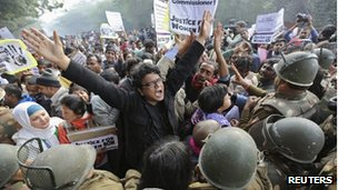 Demonstrators shout slogans as they are surrounded by the police during a protest rally in New Delhi