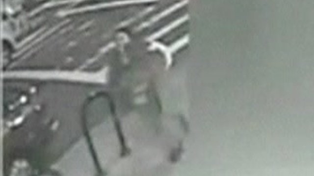 CCTV of woman running