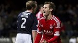 Niall McGinn celebrates after scoring against Dundee