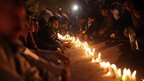 Mourners in India hold a candlelit vigil for the rape victim