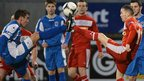 Grant Hutchinson of Dungannon Swifts goes toe-to-toe with Cliftonville winger Martin Donnelly at Solitude