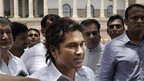 Sachin Tendulkar, centre, talks to the media outside the parliament after taking oath as a member of Rajya Sabha, in New Delhi.