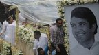 Bollywood actress Dimple Kapadia (L) travels in a float bearing the coffin of her husband Rajesh Khanna in Mumbai on 19 July 2012