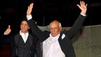 In this file photograph taken on September 27, 2012 Indian Veteran Bollywood filmmaker, director, screenwriter and producer Yash Raj Chopra (R) gestures as he celebrates his 81st birthday with actor Shah Rukh Khan at a film promotion in Mumbai