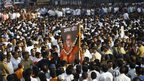 "Indian mourners carry a poster of Bal Thackeray with the words ""Long Live"" during his funeral in Mumbai, India"