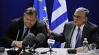 Greek Finance Minister Evangelos Venizelos (L) and Greek Prime Minister Lucas Papademos (R) give a joint press conference in Brussels, 21 February