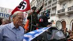 Protesters in Athens mock Germany with Nazi symbols, 9 October