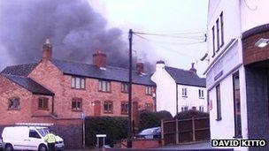 Smoke above houses