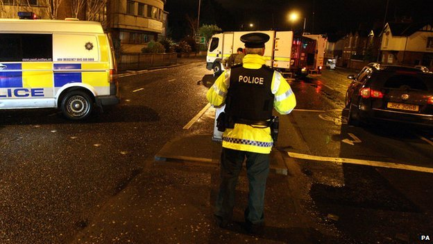 Police seal off a road in Belfast.