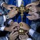 Members of Team Europe lay hands on the Ryder Cup
