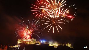Fireworks go off over Edinburgh Castle as part of the new year 2013 Edinburgh Hogmanay celebrations in Scotland