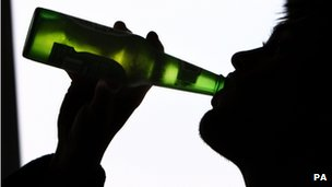 File photo of a person drinking a bottle of beer