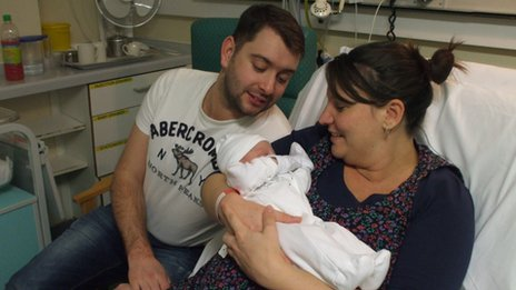 Paul and Amy Davison with baby Evie
