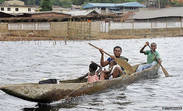 Villagers in a pirogue on Ebrie Lagoon