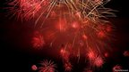 Red fireworks explode across the sky in Zurich, Switzerland. Picture: Svetoslava Slavova