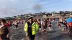 Crowds running into the seat at Saundersfoot in Pembrokeshire for the New Year's Day swim