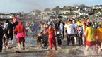 More crowds running into the water at Saundersfoot beach in Pembrokeshire for the annual New Year's Day swim