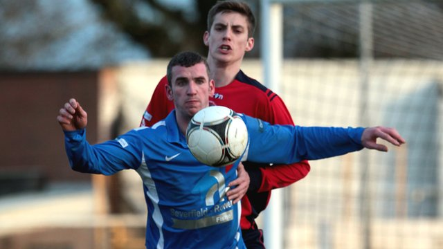 Ballinamallard's Ryan Campbell shields the ball from Andrew Ferguson