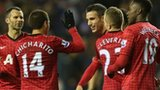 Man Utd players celebrate their victory over Wigan