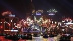 Fireworks explode in front of the Hong Kong Convention and Exhibition Centre over the Victoria Harbour on 1/1/13