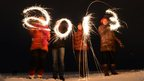 People celebrate New Year in the city of Zelenogorsk, some 55km from Saint Petersburg, 1 Jan 2013.