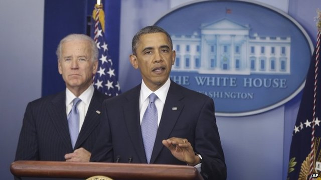 President Barack Obama, with Vice-President Joe Biden at his side, makes a statement regarding the passage of the fiscal cliff bill in the press briefing room at the White House in Washington, 1 January 2013