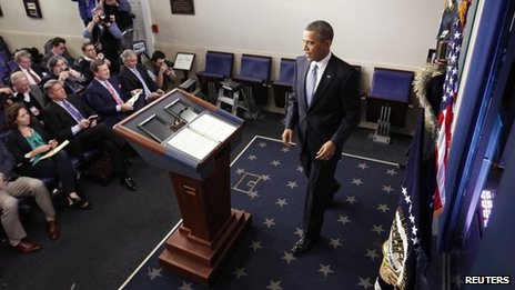 President Barack Obama arrives at the lectern to deliver remarks after the House of Representatives acted on legislation intended to avoid the &quot;fiscal cliff&quot; at the White House, Washington DC, 1 January 2013
