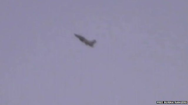 Burma military jet in sky over Kachin