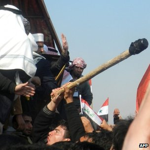 An Iraqi protesters attacks the stage where Iraq's deputy premier Saleh al-Mutlak arrived to give a speech on December 30