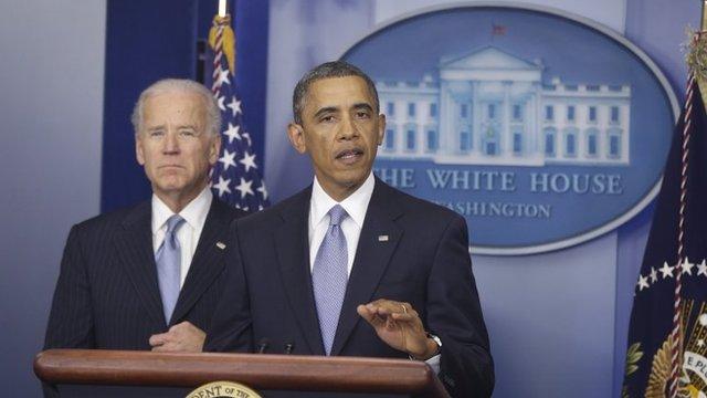 President Barack Obama, with Vice-President Joe Biden at his side
